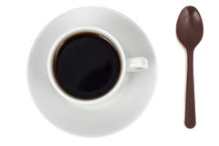 Spoon of chocolate-dessert to cup of coffee Stock Photo