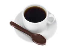 Spoon of chocolate-dessert to cup of coffee Royalty Free Stock Photography