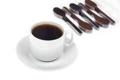 Spoon of chocolate-dessert to cup of coffee Royalty Free Stock Photos