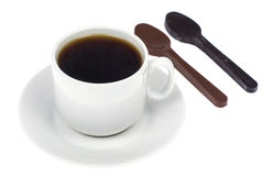 Spoon of chocolate-dessert to cup of coffee stock photos