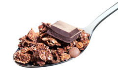Spoon with chocolate muesli isolated. Royalty Free Stock Photos