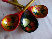 Spoon. Closeup. Khokhloma - an ancient Russian folk craft XVII century. Traditional elements Khokhloma - red juicy berries Stock Images
