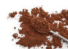 Spoon with cocoa powder. On white background royalty free stock photo