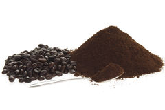 Spoon Coffee. With Coffee Beans and ground coffee on a white background royalty free stock photos