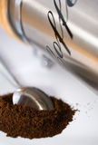 Spoon with coffee Stock Images