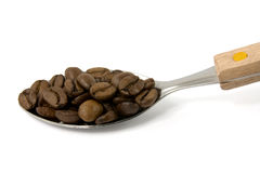 Spoon with coffee beans Stock Photography