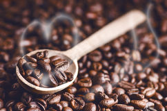 Spoon of coffee beans. Background. Energy. Raw coffee beans. Grained product. Hot drink. Close up. Harvesting. Natural background. Stock Image