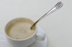 Spoon into a coffee cup Royalty Free Stock Photos