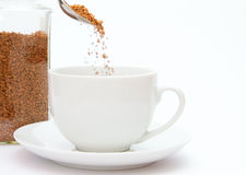 Spoon of coffee granules Royalty Free Stock Image