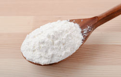 Spoon of corn starch. On wooden background Stock Photo