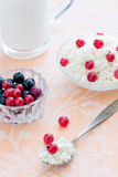 Spoon with cottage cheese and red currant. Breakfast with cottage cheese with red currant and milk Stock Photo