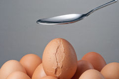 Spoon creak an egg Royalty Free Stock Photos