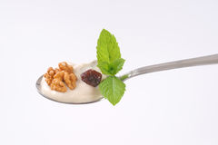 Spoon of cream cheese with nuts and raisins Royalty Free Stock Photography