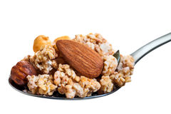 Spoon with crunchy muesli and nuts. Royalty Free Stock Photos