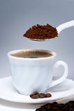 Spoon and Cup of coffee Stock Photos