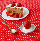 Spoon and delicious strawberry with sugar Royalty Free Stock Photo
