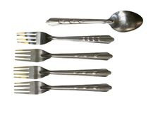 Spoon in difference a row of forks. Royalty Free Stock Image
