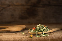 Spoon with dried oregano and thyme, basil and vegetables Royalty Free Stock Photos