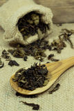 Spoon of dried tea leaves Stock Photography