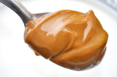 Spoon with Dulce de leche Stock Photography