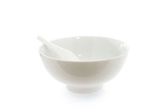 Spoon in  empty bowl Stock Image