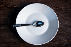 Spoon and empty dish Royalty Free Stock Image