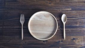 Wooden tableware on wooden background Royalty Free Stock Image