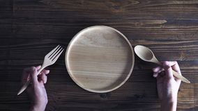 Wooden tableware on wooden background Royalty Free Stock Photo
