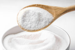 Spoon filled with sugar Stock Photos