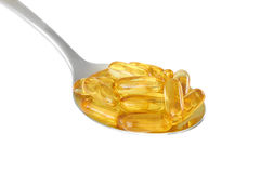 Spoon with fish oil supplements Royalty Free Stock Photography