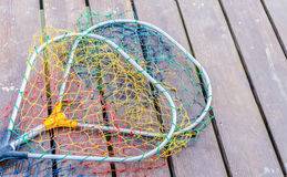 Spoon fishing net. On a wooden table Royalty Free Stock Image