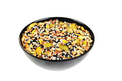 Bowl with flax seeds, sunflower seeds, sesame, chia and pumpkin seeds. Black bowl, white background Royalty Free Stock Images