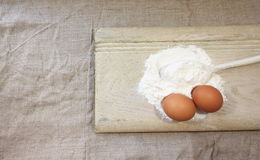 Spoon flour on a wooden board Stock Images