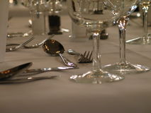 Spoon and Fork. Dining table setting. Focus is on the spoon and fork stock image