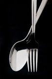 Spoon and fork in black background Royalty Free Stock Image