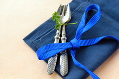 Spoon and fork in  blue  napkin Stock Images