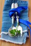 Spoon and fork in  blue  napkin Royalty Free Stock Images