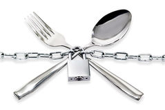 The spoon and fork with a chain and padlock Stock Images