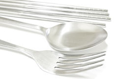 Spoon, fork and chopsticks Stock Photo
