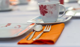 The spoon, fork and cup Royalty Free Stock Photos