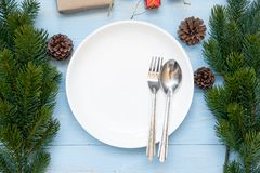 spoon, fork and Empty plate with Christmas decoration, preparation for Happy New Year and Xmas royalty free stock photo
