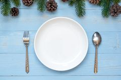Spoon, fork and Empty plate with Christmas decoration, preparation for Happy New Year and Xmas stock photo