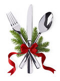 Spoon, fork and knife as christmas symbol celebration. Christmas and new year silverware for celebration as invitation design background Royalty Free Stock Image