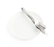 Spoon, fork and knife over the white plate Stock Images