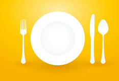 Spoon fork knife and plate Royalty Free Stock Photo
