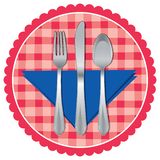 Spoon, fork and knife on table cloth Stock Images