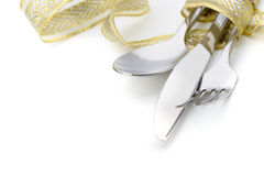 Spoon, fork and a knife tied up celebratory ribbon. It is isolated on a white background royalty free stock image