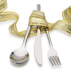 Spoon, fork and a knife tied up celebratory ribbon Stock Images