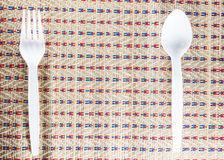 Spoon and fork on mat wicker form bamboo Royalty Free Stock Photo