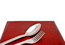 Spoon and fork on menu cover Stock Photos